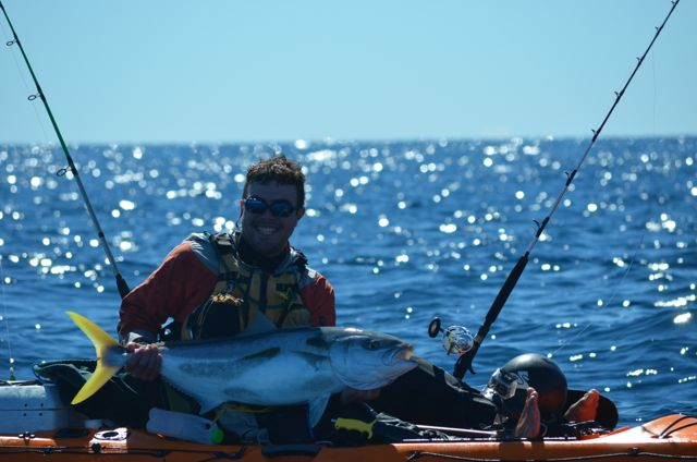 Tim Taylor with a kingfish caught from his kayak at Mayor Island