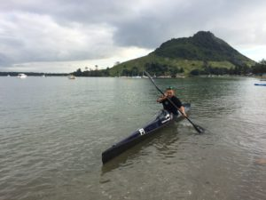 Jarrod test paddles a full carbon fibre F1 in the Tauranga Harbour